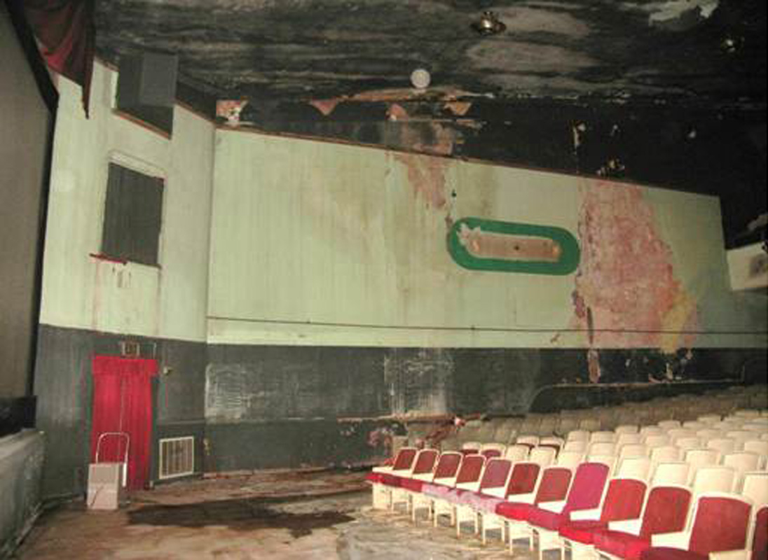 View of the auditorium prior to restoration.  Although not evident, peeling paint left ghost traces of the original paint scheme in some areas.