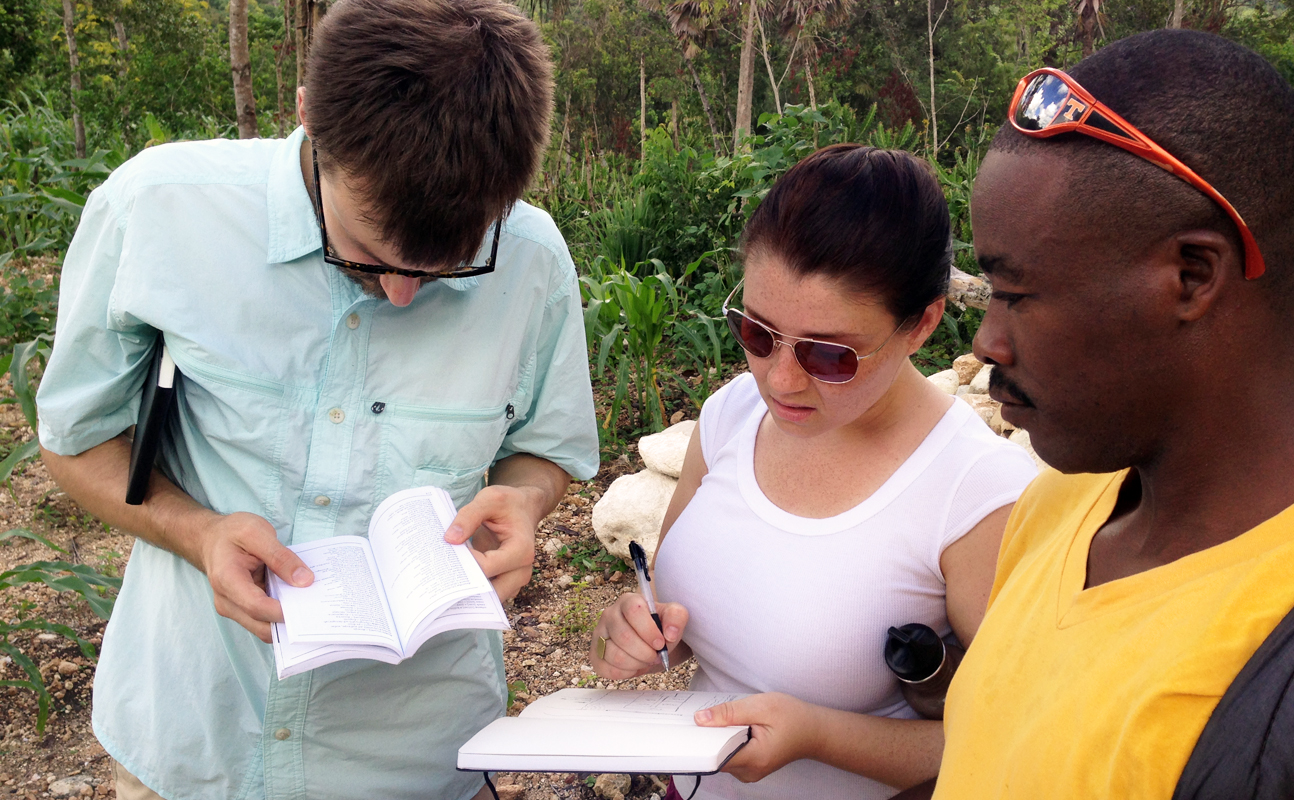 Andy Godwin and Susanne Tarovella with Toto, collaborating on plans for a house for Toto's family in Fond Des Blancs, Haiti (photo: John McRae)