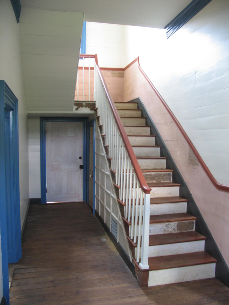 Restored entry hall and stair.  Specialty restoration painting ongoing.