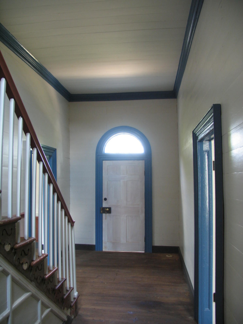 View towards entry door. Specialty restoration painting ongoing.