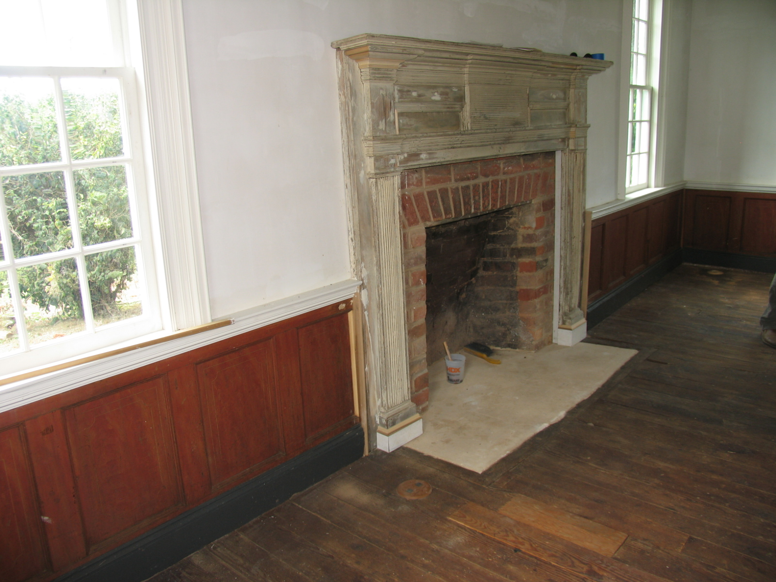West parlor with restored wainscot.  Mantle restoration and wallpaper restoration ongoing.